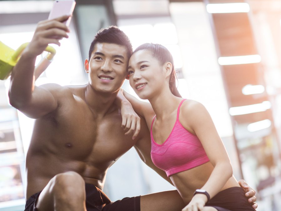 Couple Taking Selfie In Gym