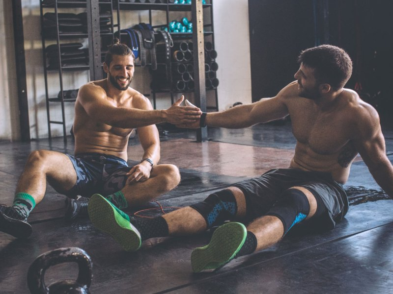 Men Resting In Gym
