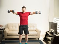 Man Lifting Dumbbells In Shoulder Raise