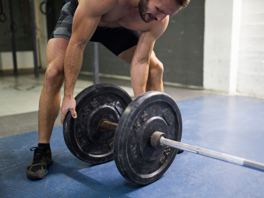 Man Placing On Weights