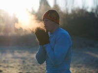 Man Warming Hands During Winter Workout