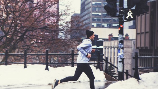 Runner jogging through a city on a winter day