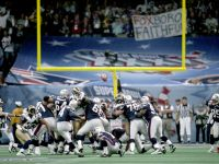 New England Patriots kicker Adam Vinatieri (4) attempts a kick during Super Bowl XXXVI