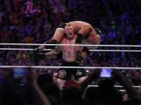 Brock Lesnar Prepares A F5 With Goldberg On His Shoulders.