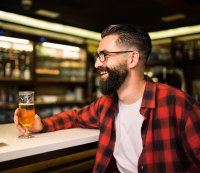 Man with a beer and a beard