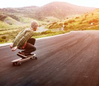 """Ask Men's Fitness: """"I'm Thinking of Getting Into Longboarding—it Seems a Little Less Intense Than Skateboarding but Still a Cool Way to Get Around. What Should I Look for in a Good Longboard?"""""""