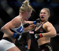 "Fit Fix: As Holly Holm Basks in Her Win, Ronda Rousey Promises ""I'll Be Back"""