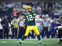 Aaron Rodgers #12 of the Green Bay Packers looks to pass during the NFC Divisional Playoff game against the Dallas Cowboys at AT&T Stadium on January 15, 2017 in Arlington, Texas.