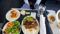 Man in business class eating airline food