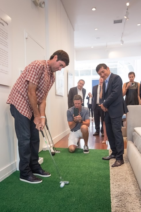 Bubba Watson holds a putting demo at the airweave store in New York
