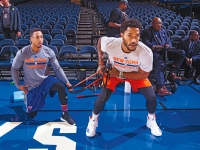 "Mubarak ""Bar"" Malik warms up Derrick Rose before a New York Knicks game."