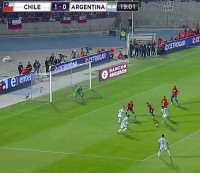 Argentina's Ángel Di María curls a shot around defenders for a goal against Chile.