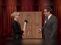 Jimmy Fallon and Jennifer Lawrence competing in axe-throwing competition