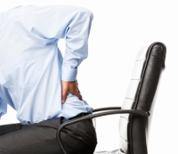 Ask Men's Fitness: How Can I Protect My Back at Work?