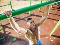 Man doing pullups outdoors