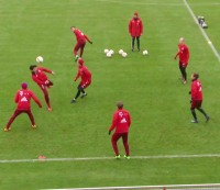 """FC Bayern Munich players practice with a """"rondo"""" drill."""