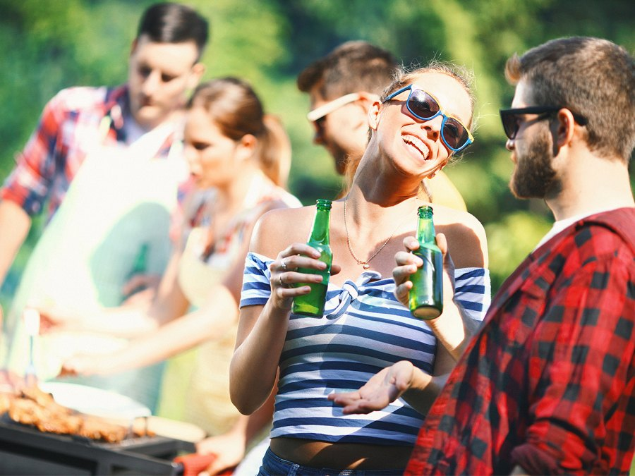 Young Adults Drink Beer At A Summer Barbecue