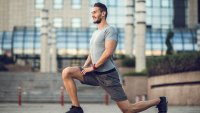 Fit man lunging