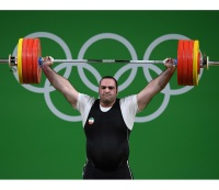 Behdad Salimi and Lasha Talakhadze Set and Re-Set Weightlifting Records in Olympic Clash of the Titans