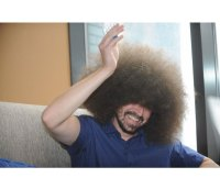 """Man Earns Guinness World Record for """"Largest Male Afro"""""""