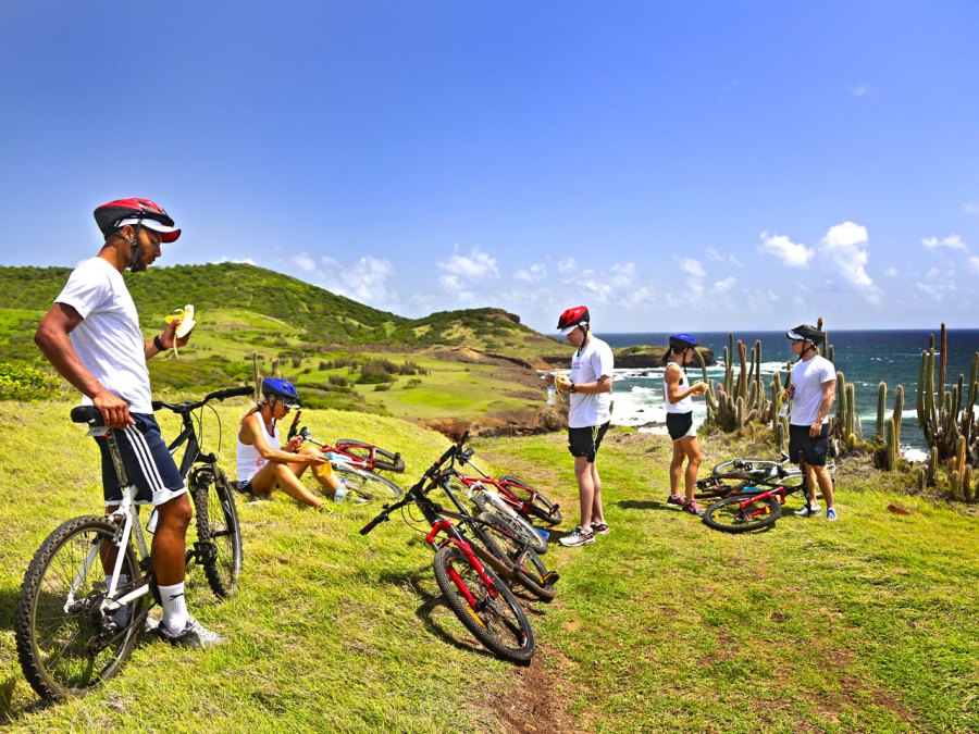 Men and women riding bikes with Body Holiday