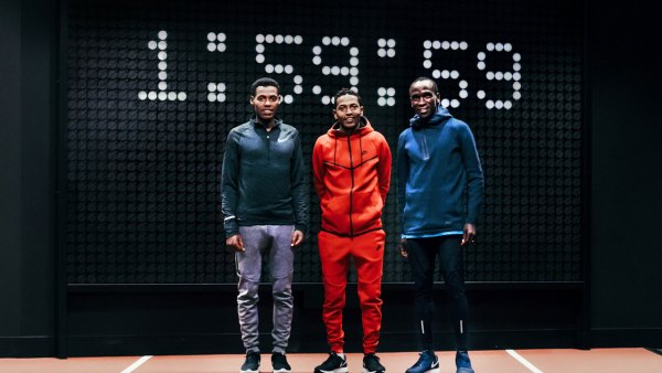 Breaking2 Nike athletes standing in front of clock