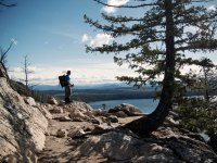 A hiker takes in the view from Inspiration Point, Grand Teton National Park