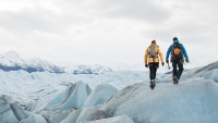 two hikers trekking on ice