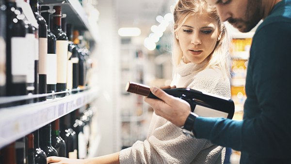 Couple Buys Wine at Store