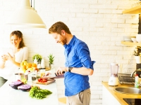 Young Couple Cooks Dinner Together In Kitchen