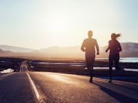 Couple Running at Sunrise