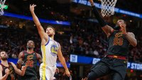 LeBron James #23 of the Cleveland Cavaliers and Stephen Curry #30 of the Golden State Warriors