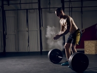 Man Deadlifting Weighted Barbell