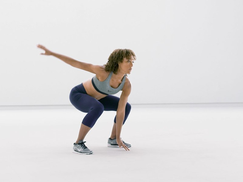 Woman demonstrating Drop Squat