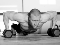 Man Performing Dumbbell Pushup