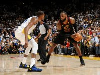 Kevin Durant #35 of the Golden State Warriors defends against LeBron James #23 of the Cleveland Cavaliers