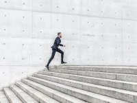 Fashionable Man Running Up Stairs