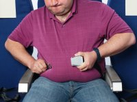 Overweight man on airplane