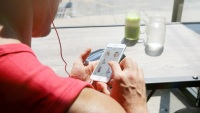 Man Tracking Fitness With Phone App