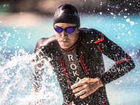 Triathlete wearing Roka wetsuit