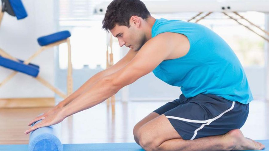 You're Probably Foam Rolling Wrong. Here's How to Do It Right.