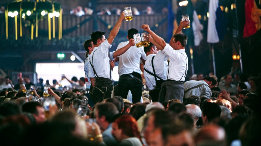 Men toasting with beers at Oktoberfest in Munich