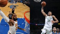 LeBron James #23 of the Cleveland Cavaliers and Giannis Antetokounmpo #34 of the Milwaukee Bucks