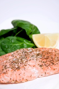 6. Grilled salmon over spinach & whole-wheat couscous