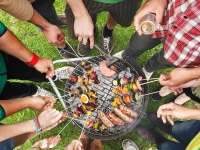 Friends Grill Vegetable Skewers and Sausages at Labor Day Picnic