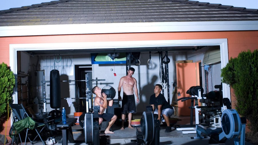 Men Working Out at Home Gym