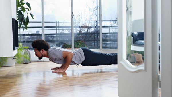 Man doing pushups at home