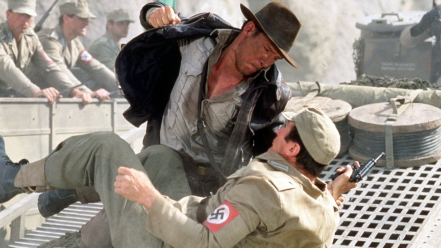 American actor Harrison Ford as the eponymous archaeologist ndiana Jones in a scene from the film 'Indiana Jones and the Last Crusade', 1989. Here, he has a fistfight with a German soldier atop a moving tank.