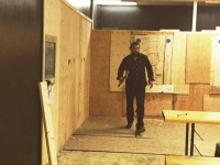 Jason Momoa practices his axe-throwing skills.