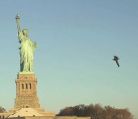 Jetpack Aviation entrepreneur David Mayman flies around the Statue of Liberty.